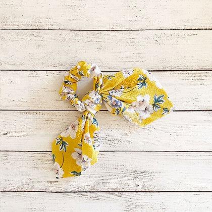 Colet cinta flores amarillo