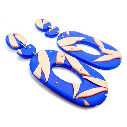 Aros Cocó Base azul con pétalos rosa claro