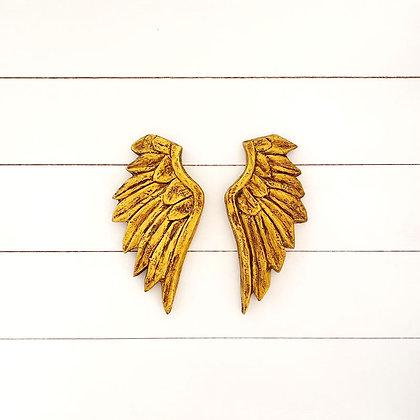 Pareja de alas doradas