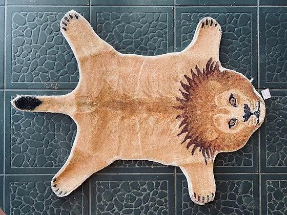Alfombra león