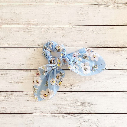 Colet cinta flores celeste