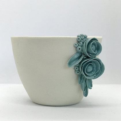 Maceta flor lateral turquesa