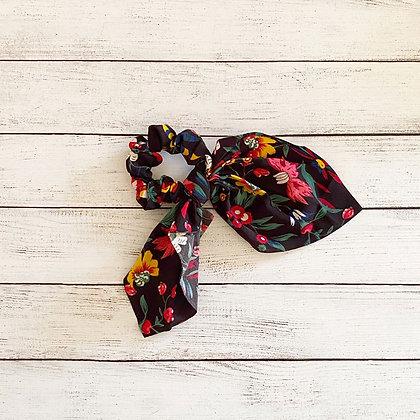Colet cinta flores negro