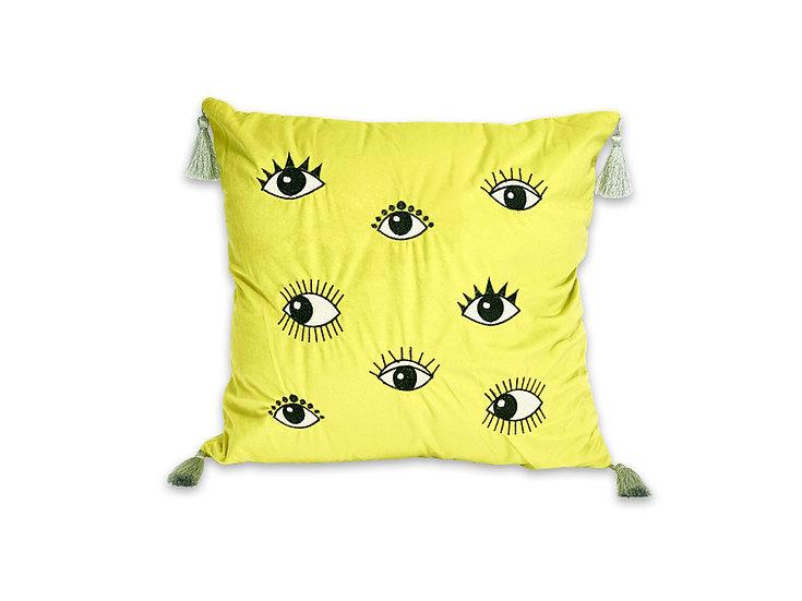 Cojín velvet ojos amarillo con borlas