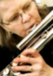 Karen playing bass flute at Davenport Jaycee's Bridal Expo
