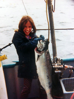 Dawn when she was a young girl, showing off her large wild alaskan salmon catch