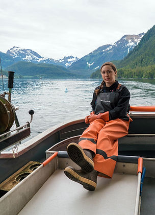 Kaisha, the daughter and deckhand of the owners hanging out on the back deck of the Bella Dawn, a fishing vessel used in catching salmon