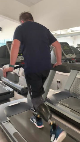 Fat bloke with no legs on a treadmill!