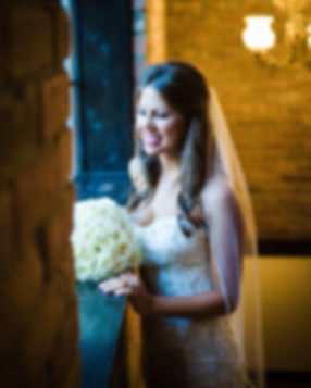 Stunning Bride looking out at her arriving guests before her walk down the aisle. Black and White Image. The Gallery Event Venue, Houston, Texas