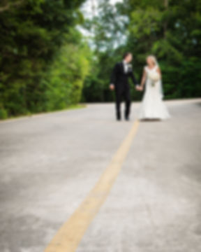 Bride & Groom celebrating their wedding vows with a cherished intimate walk down the secluded modern driveway at Ashton Gardens, Houston, Texas