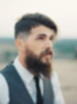 Film portrait of handsome groom atop of Enchanted Rock, Fredericksburg, Texas