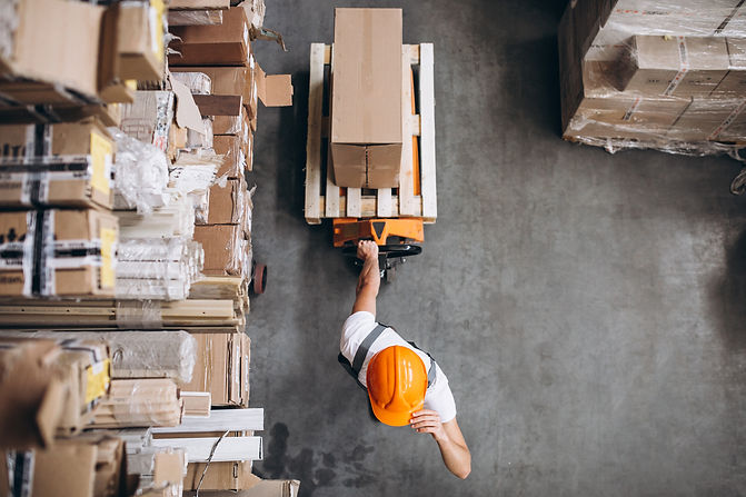 young-man-working-warehouse-with-boxes.j