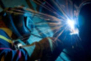 Man welding a car.jpg