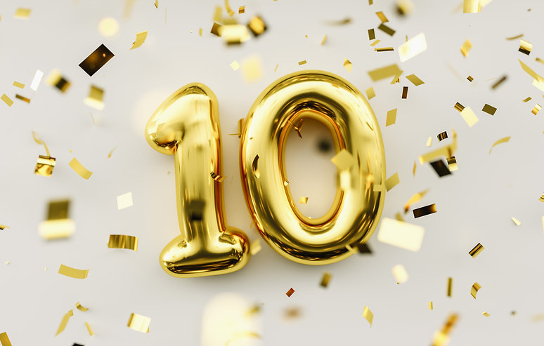 10 years old. Gold balloons number 10th