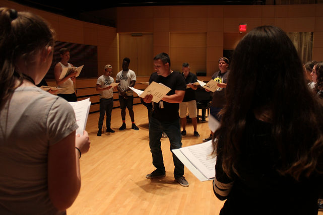 Students learning a cappella music from educators