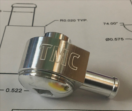 Custom Motorcycle Fuel Fitting. The Elco Team enhanced the design features of this assembly to make it beautiful as well as functional.