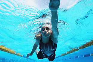 Swimming woman has the same sensations as when relieve sciatica with inversion therapy
