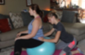Sitting on the birth ball.JPG
