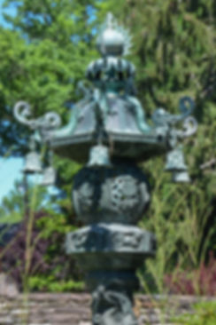 Large Japanese Bronze Lantern with Trees in Background