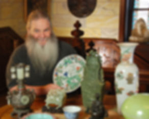 Portrait of Mark Walberg Sitting at Table with Antiques