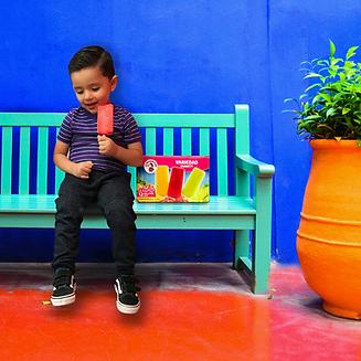 Child Enjoying La Michoacana Variety Strawberry Frozen Fruit Bar Strawberry Paletas