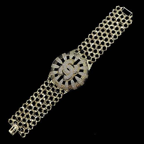 Lắc tay vàng Chanel đá trắng