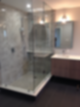 glass shower, floating vanity, marble tile shower