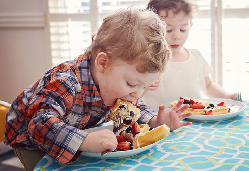 Kid eating waffle.jpeg