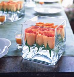 Orange Tulip buds in square glass vase.jpg