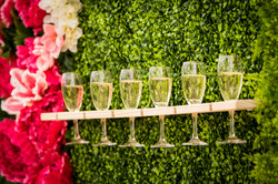 Foliage and flower wall with champagne