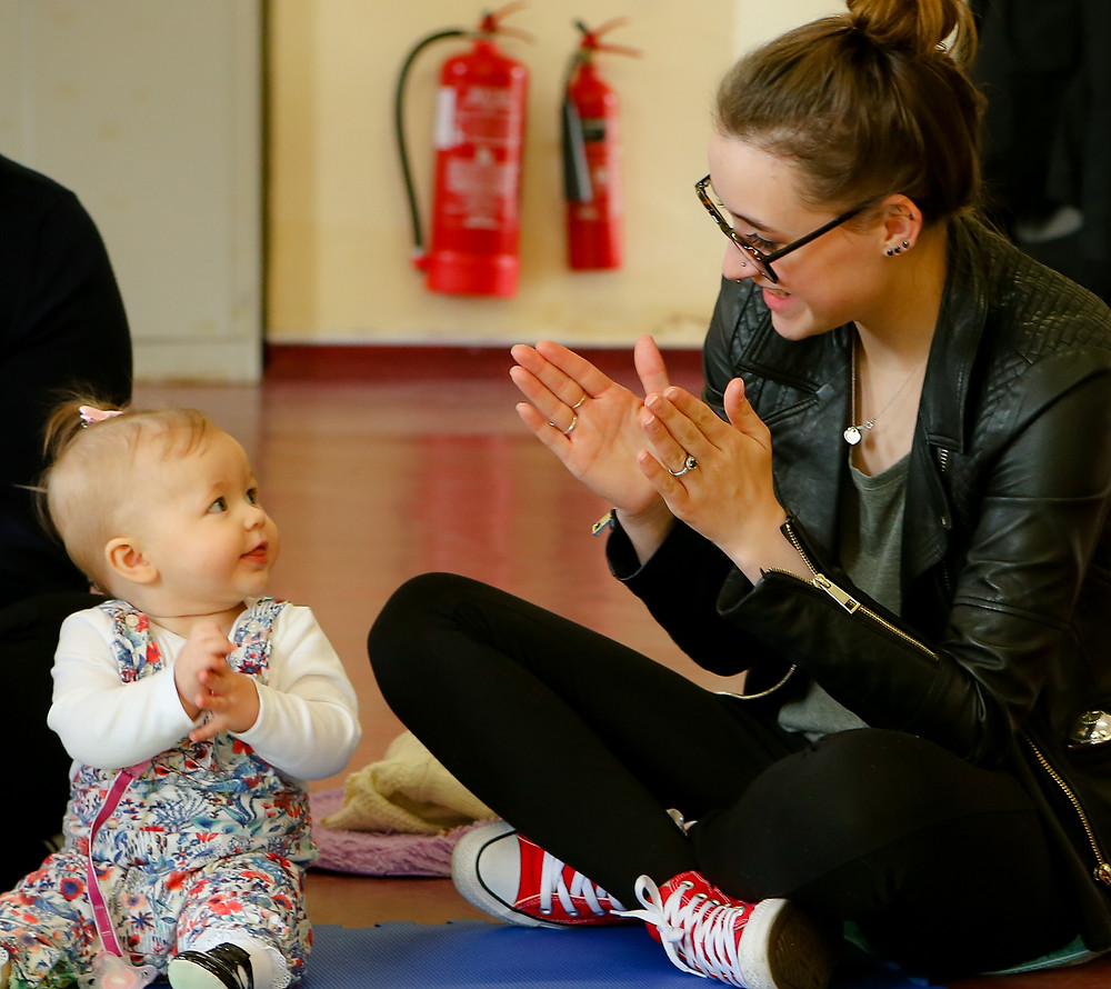 Clapping with baby