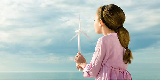 young girl and blowing onto a windmill