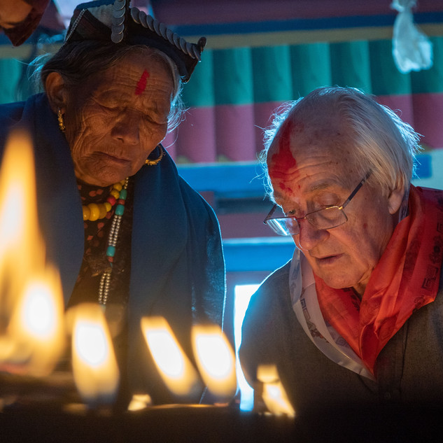 Doug and the butter lamps at Walung Gompa