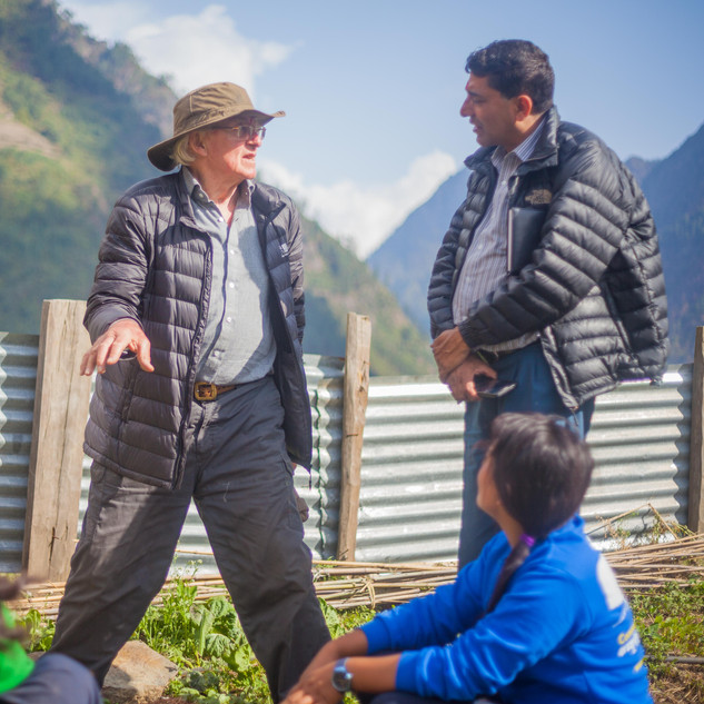 Doug discussing the benefits of organic compost to Murari, and the farming technicians at Bihi