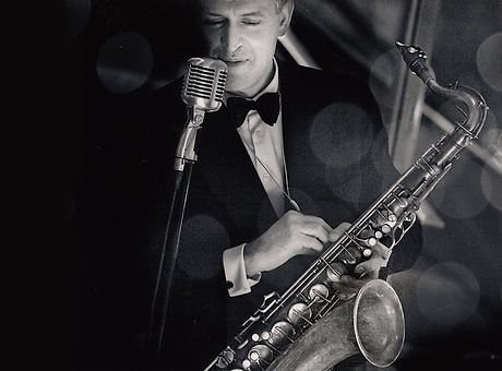 James Langton performs, as singer, saxophonist, bandleader in his swingband, NYC USA