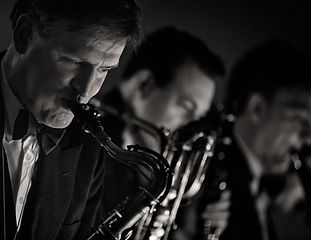 James Langton musician playing sax in his NY swing band