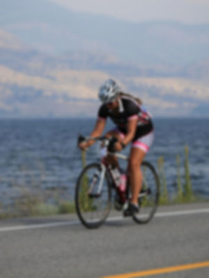 Photo of Saskia Cycling in Triathlon Gear