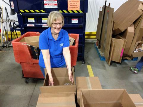 Filling boxes at the Foodbank