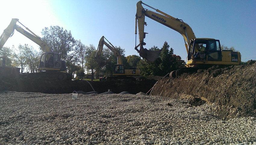 3 excavators.jpg