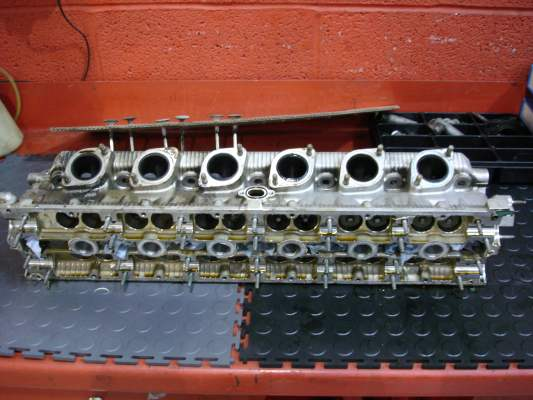 Cylinder head being checked over