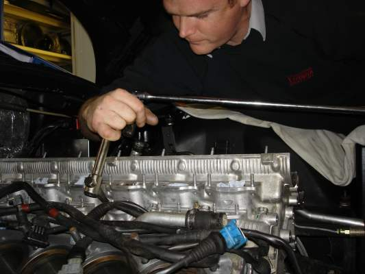 Cylinder heads being tightened