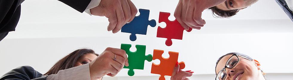 parents holding puzzle pieces.jpg