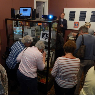 1968 Exhibit Guests view local items