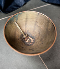 Bowl with broom