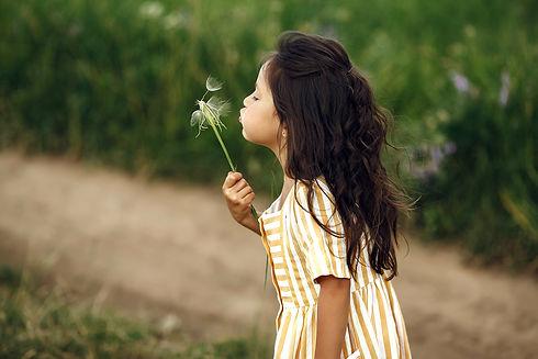 cute-little-girl-playing-in-summer-field