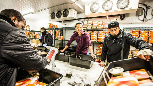 Munchery CEO Tri Tran champions the cold approach to dinner in his startup's vast, refrigerated meal-sorting room. (Eric Millette for Forbes)