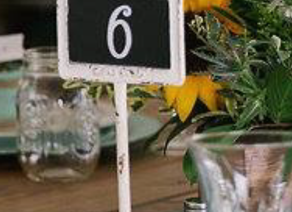 White pedestal table numbers
