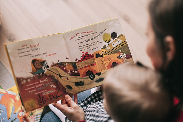Parent Reading to Young Child