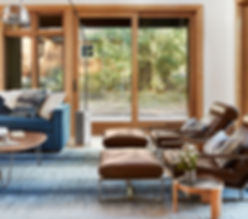 Modern furniture and Interior Design in a classic tahoe-Truckee Lahontan home. Milo Baughman Cruisin' lounge chairs and custom upholstery and window coverings.
