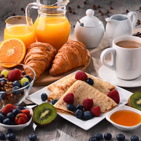 Breakfast served with coffee, orange jui